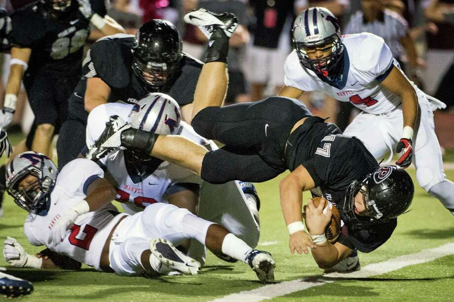 Pearland cole Hyden (17) dives into the end zone for a touchdown during the first quarter of a high school football game against Manvel at The Rig on Friday, Nov. 2, 2012, in Pearland. Photo: Smiley N. Pool, Houston Chronicle / © 2012  Houston Chronicle