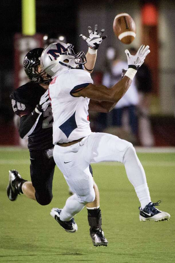 Manvel wide receiver Carlos Thompson (1) reaches for a pass as Pearland defensive back Conner Chidester (20) defends during the first quarter of a high school football game at  The Rig on Friday, Nov. 2, 2012, in Pearland. Photo: Smiley N. Pool, Houston Chronicle / © 2012  Houston Chronicle