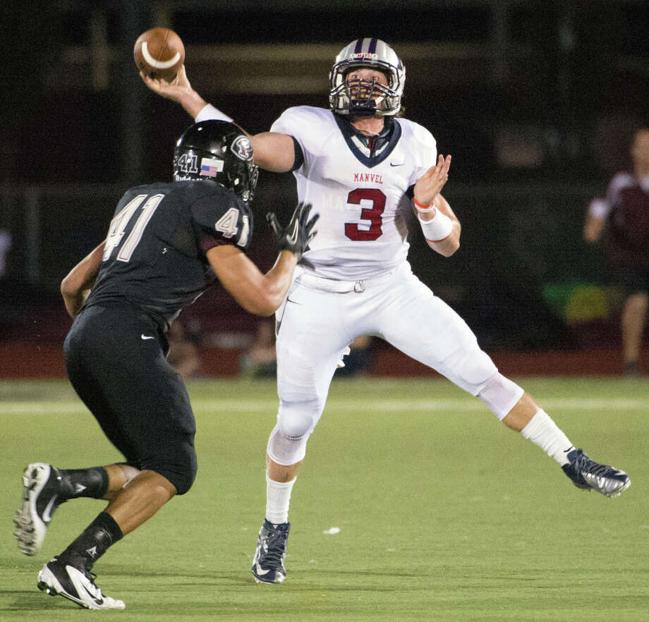 Manvel quarterback Shane McCarley (3) throws a pass over Pearland defensive end Deonte Givens (41) during the first quarter of a high school football game at The Rig on Friday, Nov. 2, 2012, in Pearland. Photo: Smiley N. Pool, Houston Chronicle / © 2012  Houston Chronicle