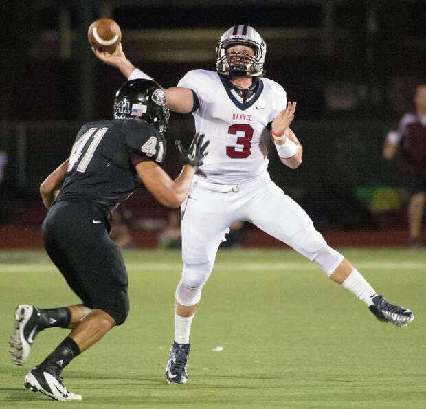 Manvel quarterback Shane McCarley (3) throws a pass over Pearland defensive end Deonte Givens (41) d