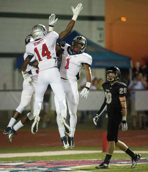Manvel wide receiver Carlos Thompson (1) celebrates with Austin Bennett (14) as Pearland defensive b