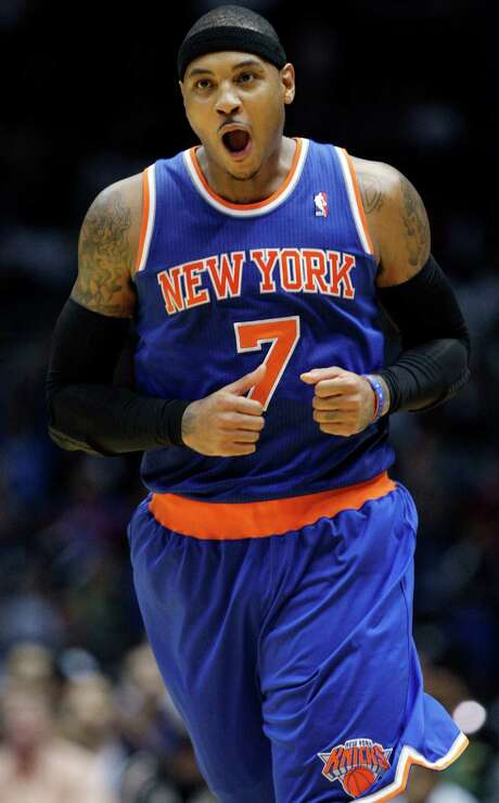 New York Knicks' Carmelo Anthony (7) reacts after scoring during the second half of a preseason NBA basketball game against the Brooklyn Nets, Wednesday, Oct. 24, 2012, in Uniondale, N.Y.  (AP Photo/Frank Franklin II) Photo: Frank Franklin II, STF / AP