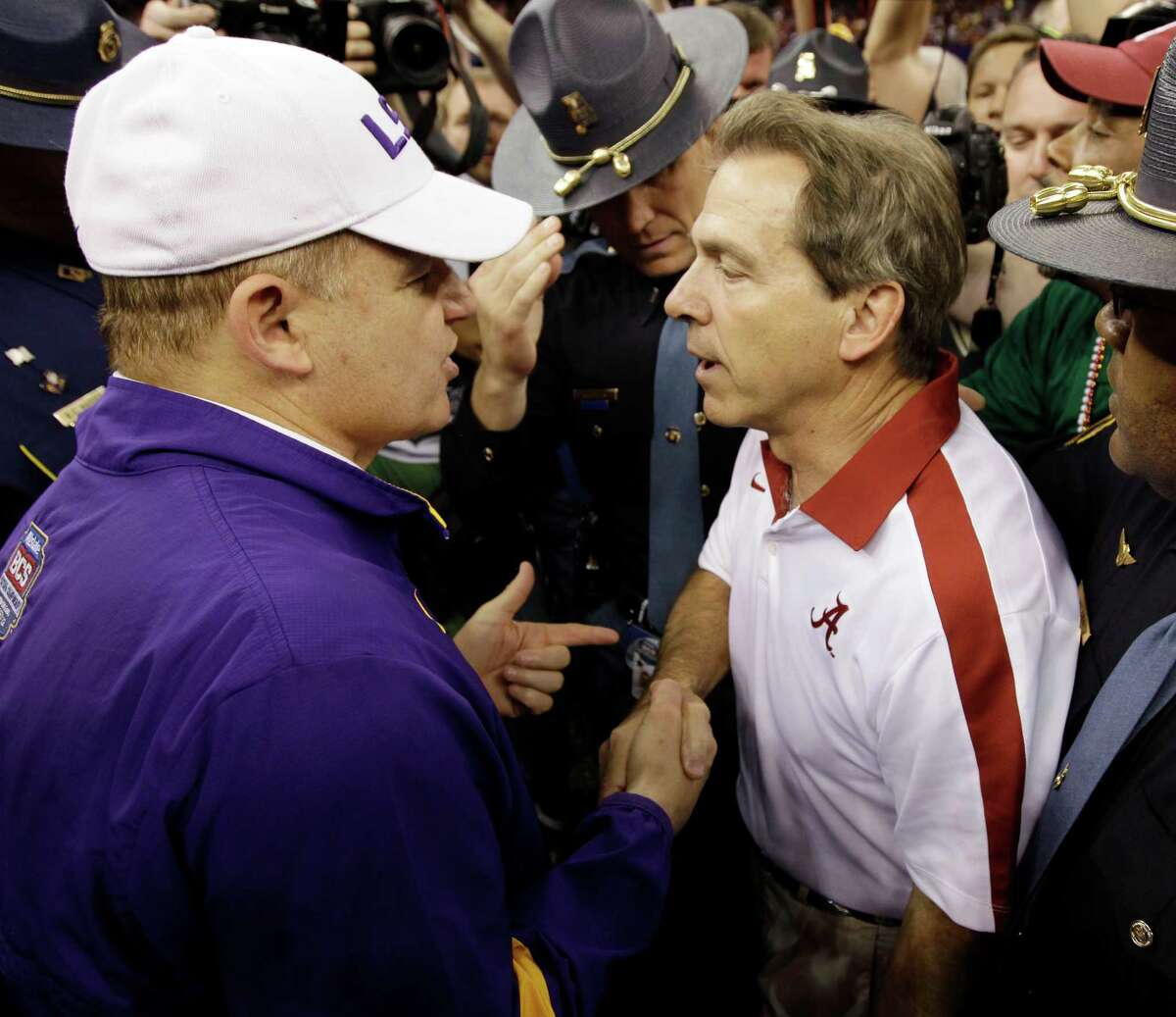 FILE - In this Jan. 9, 2012, file photo, LSU head coach Les Miles, left, talks to Alabama head coach Nick Saban after the Crimson Tide won 21-0 in the BCS National Championship NCAA college football game in New Orleans. Alabama-LSU has become the greatest rivalry in college football, and it's time for another epic showdown: No. 1 Crimson Tide vs. No. 5 Tigers on Saturday. (AP Photo/David J. Phillip, File)