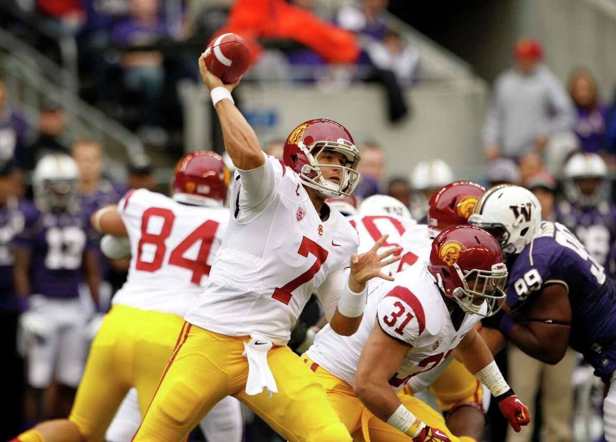 FILE - In this Oct. 13, 2012, file photo, Southern California's Matt Barkley throws a pass against Washington during an NCAA college football game in Seattle. Barkley and his mates aren't looking to salvage their season, but simply hoping to keep up with No. 2 Oregon on Saturday. (AP Photo/Elaine Thompson, File)