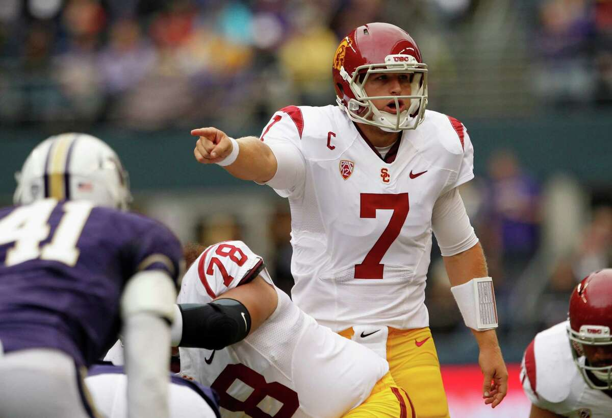 FILE - In this Oct. 13, 2012, file photo, Southern California's Matt Barkley directs his team at the line of scrimmaage during an NCAA college football game against Washington in Seattle. Barkley and his mates aren't looking to salvage their season, but simply hoping to keep up with No. 2 Oregon on Saturday. (AP Photo/Elaine Thompson, File)