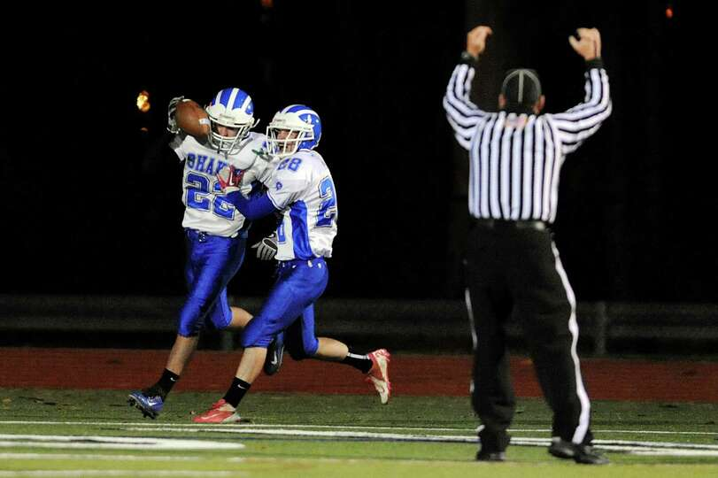 Shaker's Michael Mainella (22), left, celebrates his touchdown with Michael Lewis (28) during their