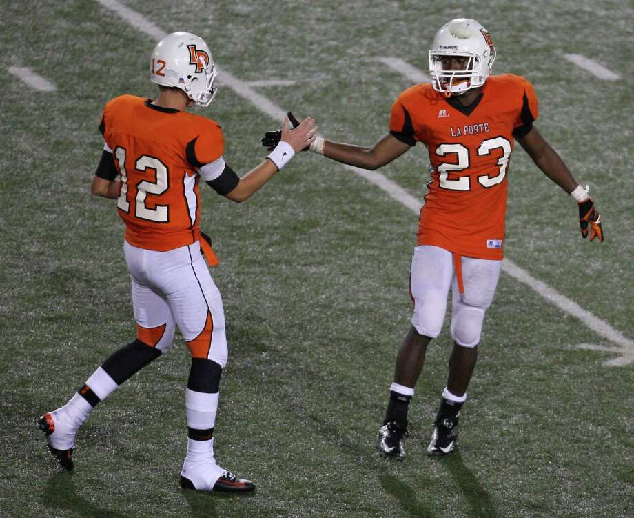 La Porte quarterback Jordan Jackson (12) celebrates the Bulldogs' 27-13 victory over North Shore with running back Johnathan Lewis during the second half of a high school football game, Friday, November 2, 2012 at Bulldog Stadium in La Porte, TX. Photo: Eric Christian Smith, For The Chronicle