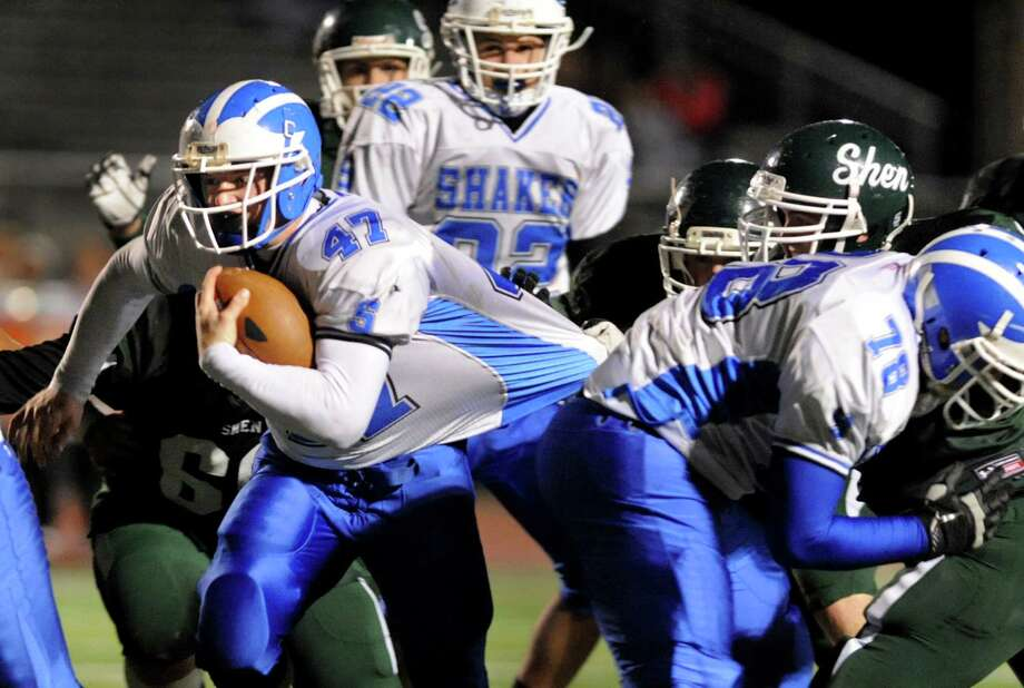 Shaker's Ryan Griffin (47), left, can't be slowed down during their Class AA Super Bowl football game against Shen on Friday, Nov. 2, 2012, at Shenendehowa High in Clifton Park, N.Y. (Cindy Schultz / Times Union) Photo: Cindy Schultz / 00019908A