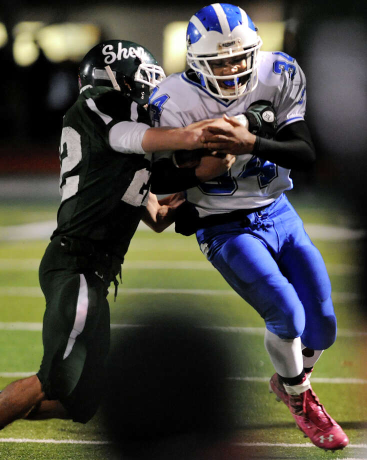 Shaker's Kenny Jackson (34), right, runs the ball as Shen's Corey Acker (22) defends during their Class AA Super Bowl football game on Friday, Nov. 2, 2012, at Shenendehowa High in Clifton Park, N.Y. (Cindy Schultz / Times Union) Photo: Cindy Schultz / 00019908A