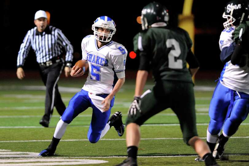 Shaker's quarterback Chris Landers (5), left, runs the ball as Shen's D.J. Edick (2) defends during