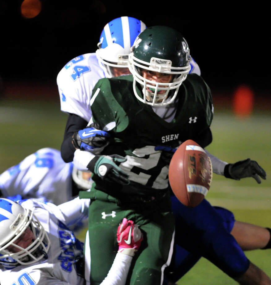 The ball pops out when Shen's Michael Mainella (22) gets tackled during their Class AA Super Bowl football game against Shaker on Friday, Nov. 2, 2012, at Shenendehowa High in Clifton Park, N.Y. (Cindy Schultz / Times Union) Photo: Cindy Schultz / 00019908A