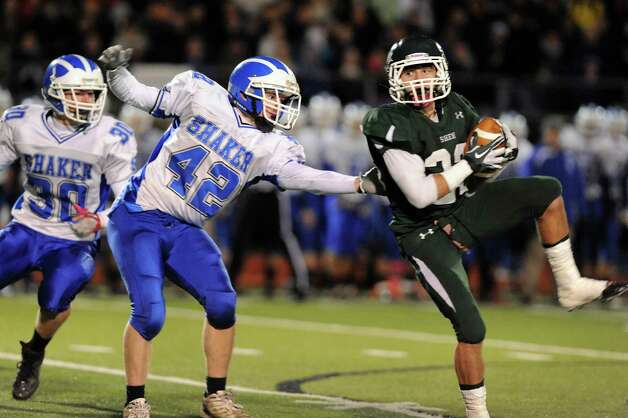 Shen's Kyle Buss (23), right, hauls in a pass as Shaker's Brandon Safford (42), center, defends during their Class AA Super Bowl football game on Friday, Nov. 2, 2012, at Shenendehowa High in Clifton Park, N.Y. (Cindy Schultz / Times Union) Photo: Cindy Schultz / 00019908A