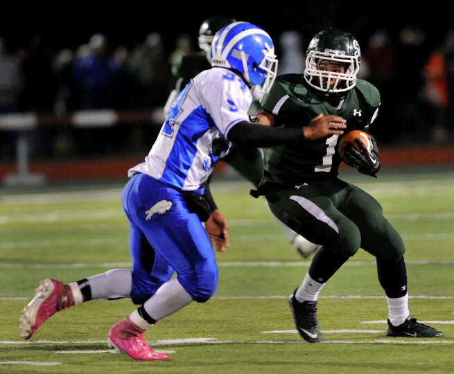Shen's Marcelino Christie (1), right, gains yards as Shaker's Kenny Jackson (34) defends during thei