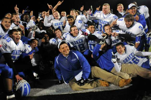 Shaker's coach Greg Sheeler, center, poses with his team after they win 14-0 over Shenendehowa their Class AA Super Bowl football game on Friday, Nov. 2, 2012, at Shenendehowa High in Clifton Park, N.Y. (Cindy Schultz / Times Union) Photo: Cindy Schultz / 00019908A