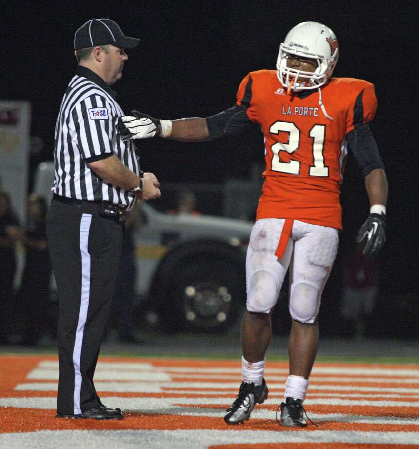 La Porte running back Keith Whitely (21) celebrates his one-yard touchdown run with an official during the second half of a high school football game against North Shore, Friday, November 2, 2012 at Bulldog Stadium in La Porte, TX. Photo: Eric Christian Smith, For The Chronicle