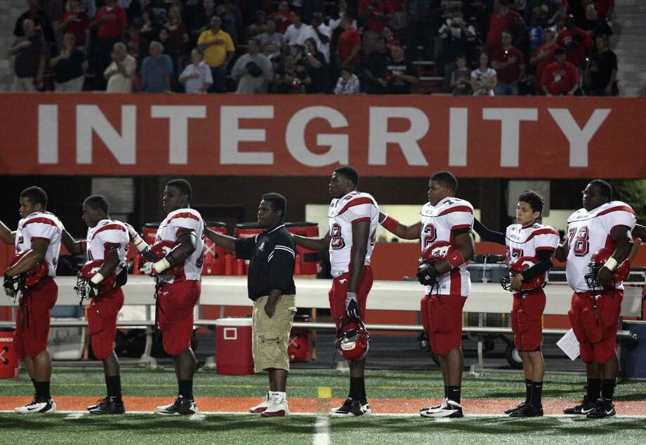 The North Shore Mustangs stand during the National Anthem before a high school football game against La Porte, Friday, November 2, 2012 at Bulldog Stadium in La Porte, TX. Photo: Eric Christian Smith, For The Chronicle
