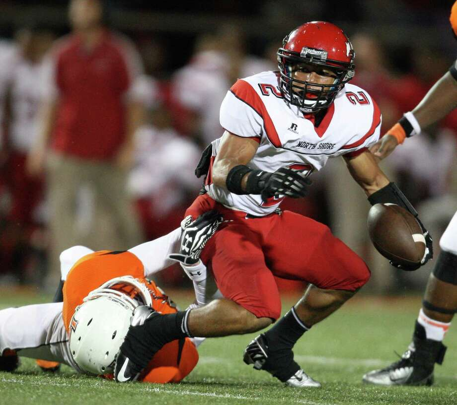 North Shore running back Kevian DeLeon (2) is tackled by La Porte linebacker Justin Pickell (88) during the first half of a high school football game, Friday, November 2, 2012 at Bulldog Stadium in La Porte, TX. Photo: Eric Christian Smith, For The Chronicle