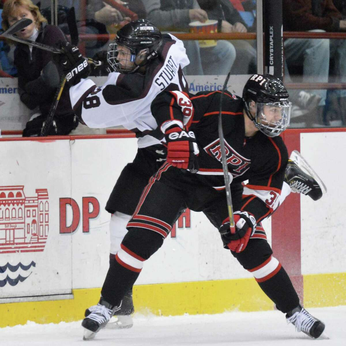Union's #28 Shaen Stuart, left, and RPI's #39 Ryan Haggerty tangle up against the boards during Saturday night's game at the Houston Field House in Troy Nov. 2, 2012. (John Carl D'Annibale / Times Union)