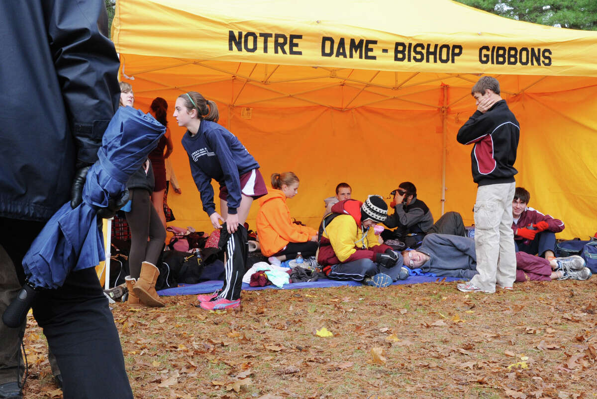 Notre Dame-Bishop Gibbons High School runners stay warm in their compound tent during the Section II Cross Country Championships on Friday Nov. 2, 2012 in Saratoga Springs, N.Y. (Lori Van Buren / Times Union)