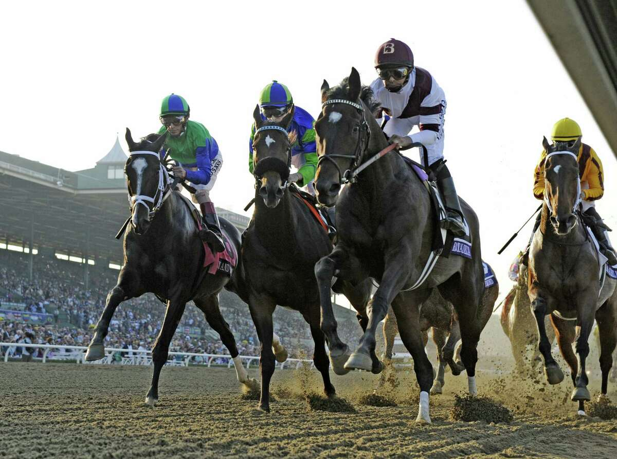Royal Delta with jockey Mike Smith , right leads the field in to the first turn and became the eventual winner of The Breeders' Cup Ladies Classic at Santa Anita Park in Arcadia, California November 2, 2012. (Skip Dickstein/Times Union)