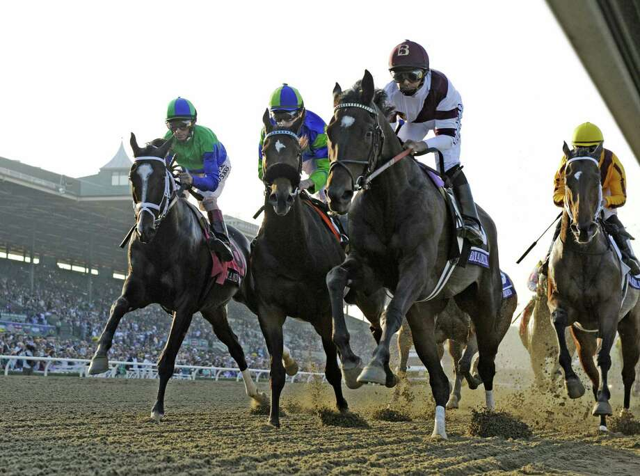 Royal Delta with jockey Mike Smith , right leads the field in to the first turn and became the eventual winner of The Breeders' Cup Ladies Classic at Santa Anita Park in Arcadia, California November 2, 2012.  (Skip Dickstein/Times Union) Photo: SKIP DICKSTEIN