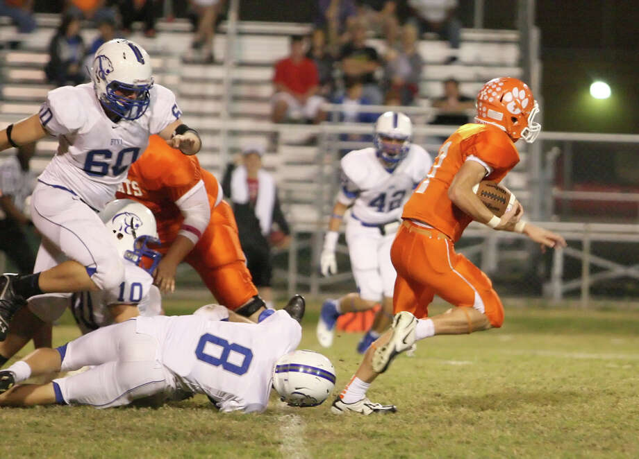 Orangefield quarterback Eric truncale, No. 7, rushes for a touchdown against Buna during the game Friday at F.L. McClain Stadium in Orangefield. (Matt Billiot/Special to the Enterprise)