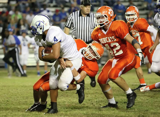 Buna running back Matthew Biddle, No. 4, is tackled by an Orangefield defender during the game Friday at F.L. McClain Stadium in Orangefield. (Matt Billiot/Special to the Enterprise)