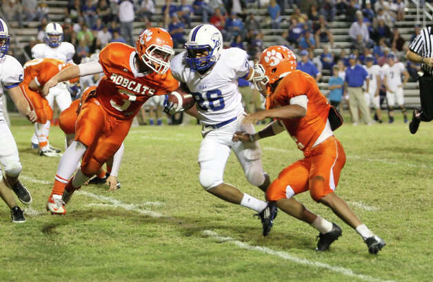 Buna running back Mason Lopez, No. 268, is denied a fourth down conversion by Orangefield during the game Friday at F.L. McClain Stadium in Orangefield. (Matt Billiot/Special to the Enterprise)