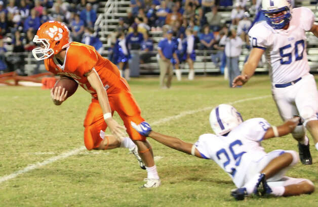 Orangefield quarterback Eric truncale, No. 7, rushes against Buna during the game Friday at F.L. McClain Stadium in Orangefield. (Matt Billiot/Special to the Enterprise)