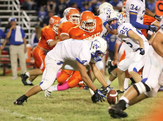 Buna running back Matthew Biddle, No. 4, scoops up a fumble during the game against Orangefield Friday at F.L. McClain Stadium in Orangefield. (Matt Billiot/Special to the Enterprise)