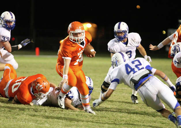 Orangefield running back Dustin Selman rushes against Buna during the game Friday at F.L. McClain Stadium in Orangefield. (Matt Billiot/Special to the Enterprise)