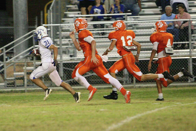 Buna running back Perry Smith, No. 31, rushes for a touchdown during the game against Orangefield, Friday at F.L. McClain Stadium in Orangefield. (Matt Billiot/Special to the Enterprise)