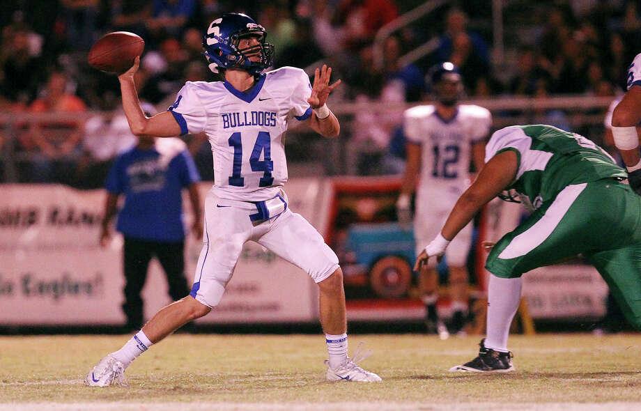 Somerset quarterback Koy Detmer drops back for a pass against Pleasanton in high school football in Pleasanton on Friday, Nov. 2, 2012. Photo: Kin Man Hui, Express-News / © 2012 San Antonio Express-News