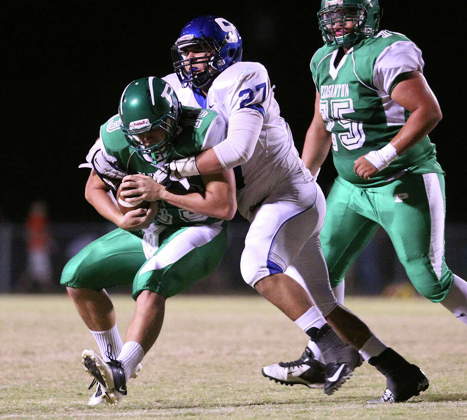 Pleasanton quarterback Luke Walters (13) gets sacked by Somerset's Donaldo Perez (27) in the second half in high school football in Pleasanton on Friday, Nov. 2, 2012. Photo: Kin Man Hui, Express-News / © 2012 San Antonio Express-News