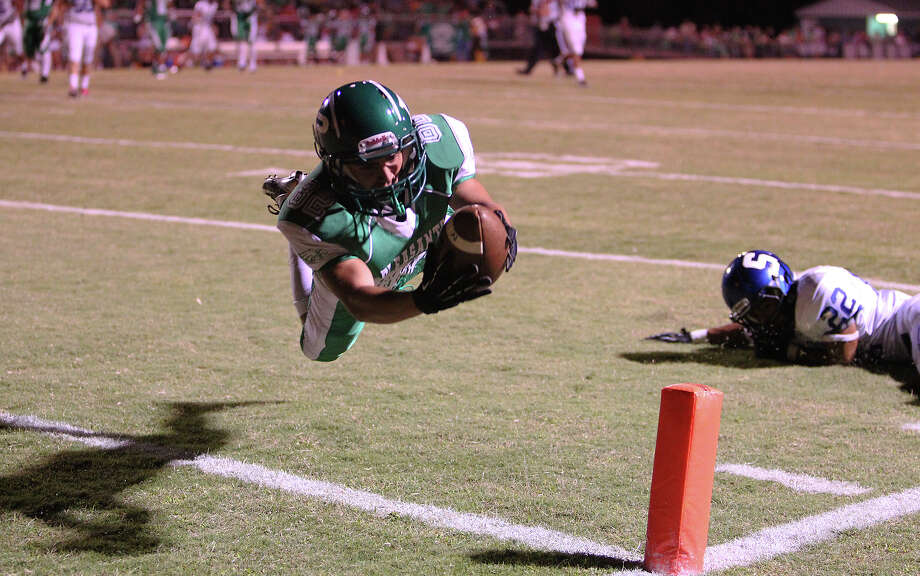 Pleasanton's Zade Llamas (82) dives in for a touchdown against Somerset's Evan Trejo (22) in the first half in high school football in Pleasanton on Friday, Nov. 2, 2012. The scored was called back due to a penalty. Photo: Kin Man Hui, Express-News / © 2012 San Antonio Express-News