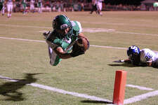 Pleasanton's Zade Llamas (82) dives in for a touchdown against Somerset's Evan Trejo (22) in the first half in high school football in Pleasanton on Friday, Nov. 2, 2012. The scored was called back due to a penalty.