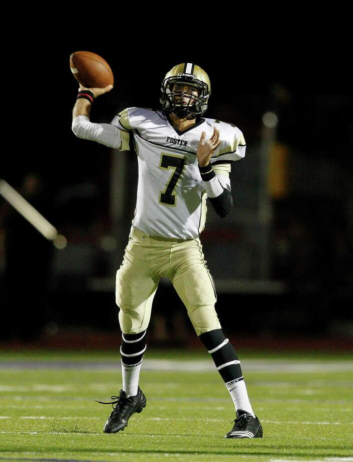 Foster quarterback Hasan Rizvi #7 throws down-field against Angleton during 24-4A high school football playoffs between Foster and Angleton, Friday, November 2, 2012 in Angleton, Texas. Photo: Bob Levey, Houston Chronicle / ©2012 Bob Levey