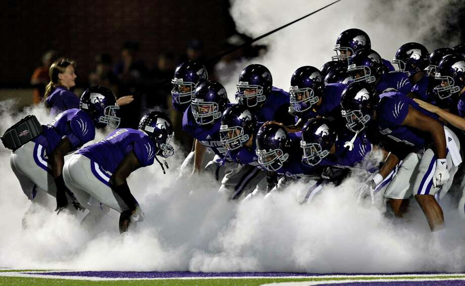 The Angleton Wildcats prepare to take the field during 24-4A high school football playoff game between Foster and Angleton, Friday, November 2, 2012 in Angleton, Texas. Photo: Bob Levey, Houston Chronicle / ©2012 Bob Levey