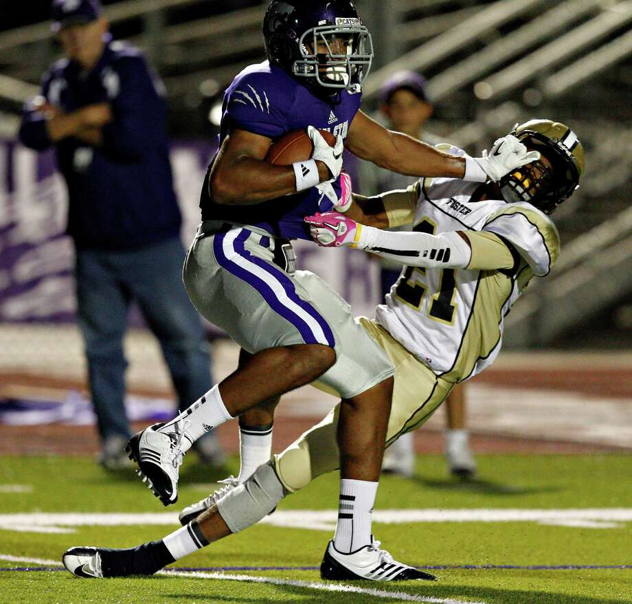 Angleton's Jalyn Judkins #9 gives Foster's Robert Jackson #21 a stiff arm as he scores in the first quarter during a 24-4A high school football playoffs between Foster and Angleton, Friday, November 2, 2012 in Angleton, Texas. Photo: Bob Levey, Houston Chronicle / ©2012 Bob Levey
