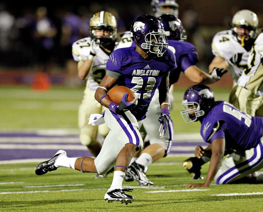 Angleton's Joshawa West #23 breaks loose for a big gain against Foster during a 24-4A high school football playoffs between Foster and Angleton, Friday, November 2, 2012 in Angleton, Texas. Photo: Bob Levey, Houston Chronicle / ©2012 Bob Levey