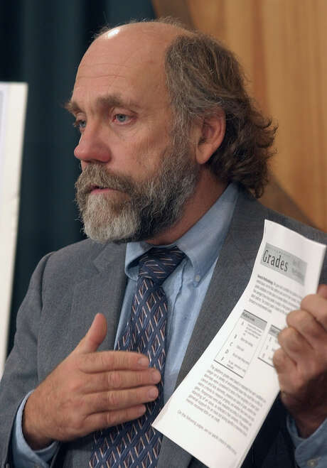 "Tom ""Smitty"" Smith, with the watchdog group Public Citizen, speaks during a news conference on Thursday, Oct. 24, 2002, in Austin, Texas. He joined other environmental and consumer groups to reveal results of a poll of candidates and how they aim to solve environmental issues. (AP Photo/Harry Cabluck) Photo: HARRY CABLUCK, STF / AP"