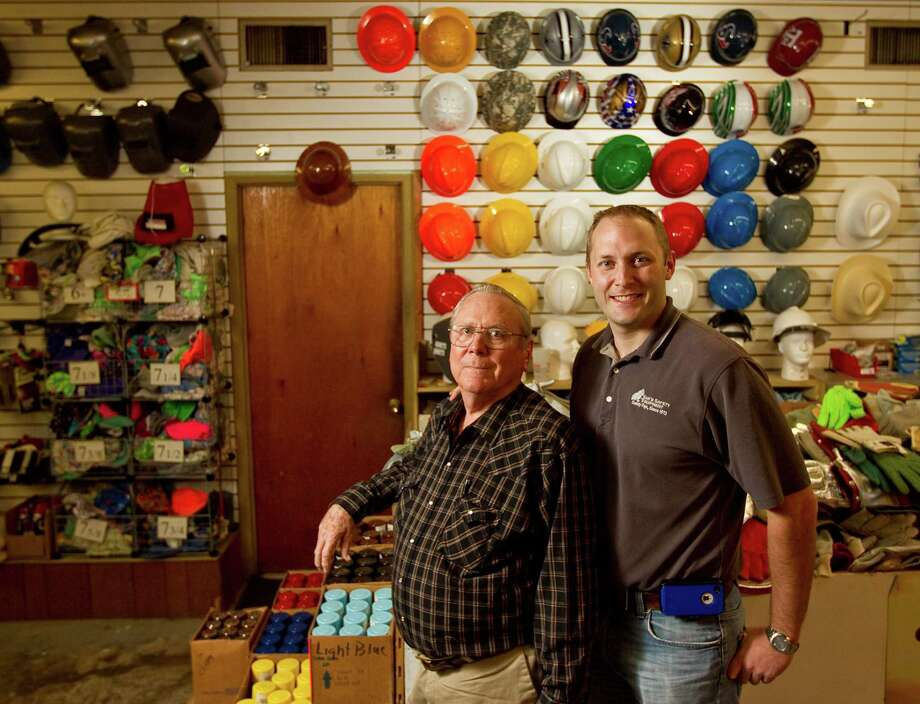 Kevin Doffing, right, credits a Goldman Sachs program for teaching him the skills to update Sam's Safety Equipment, the family business in northwest Houston. It also allowed him to make good on a promise to his father, Larry Doffing, to double sales at their shop. Photo: Nick De La Torre, Staff / Houston Chronicle