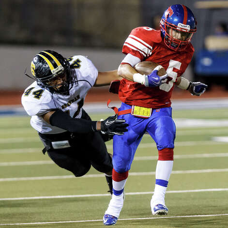 Jefferson's Mark Mangel breaks a tackle by Brennans' Grant Watanabe during the third quarter of  their game at Alamo Stadium on Nov. 2, 2012.  Brennan won the game 14-0.  MARVIN PFEIFFER/ mpfeiffer@express-news.net Photo: MARVIN PFEIFFER, Express-News / Express-News 2012