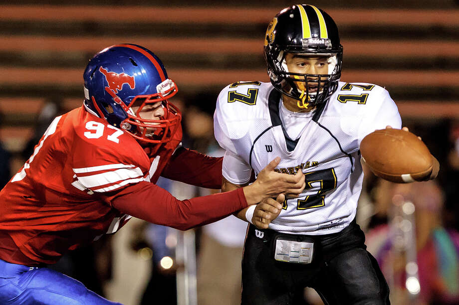 "Jefferson's Arthur Garcia (left) has Brennan quarterback Da""Shawn Key in his grasp during the second quarter of their game at Alamo Stadium on Nov. 2, 2012.  Brennan won the game 14-0.  MARVIN PFEIFFER/ mpfeiffer@express-news.net Photo: MARVIN PFEIFFER, Express-News / Express-News 2012"