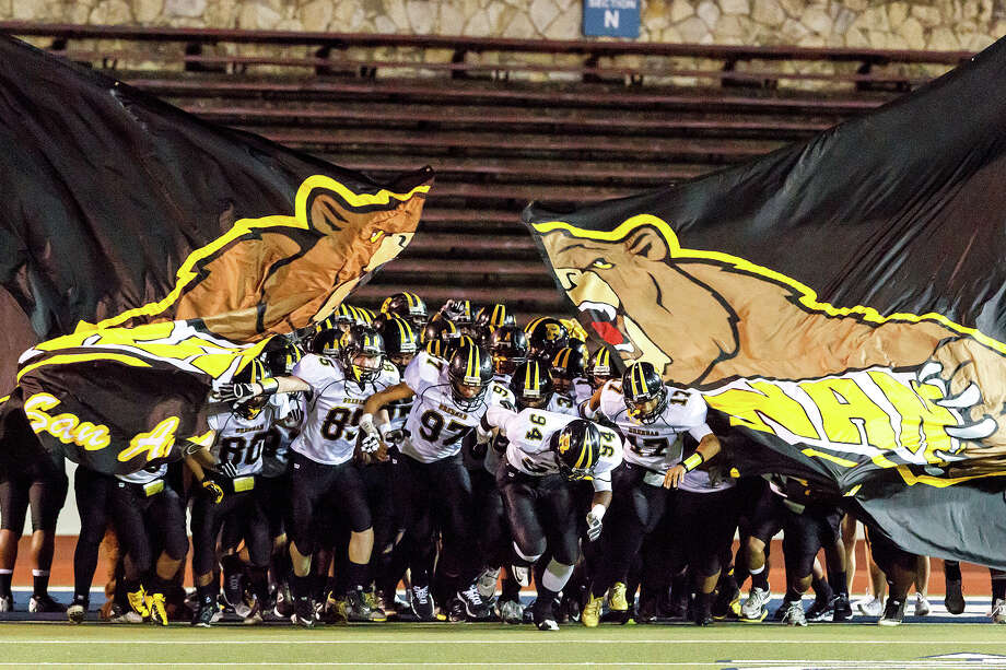 The Brennan Bears take the field prior to their game with Jefferson at Alamo Stadium on Nov. 2, 2012.  Brennan won the game 14-0.  MARVIN PFEIFFER/ mpfeiffer@express-news.net Photo: MARVIN PFEIFFER, Express-News / Express-News 2012