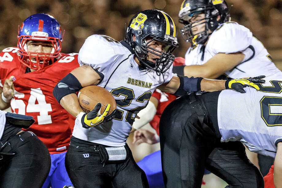 Brennan's Joshua Luna (center) breaks through the line of scrimmage during the fourth quarter of  their game with Jefferson at Alamo Stadium on Nov. 2, 2012.  Brennan won the game 14-0.  MARVIN PFEIFFER/ mpfeiffer@express-news.net Photo: MARVIN PFEIFFER, Express-News / Express-News 2012