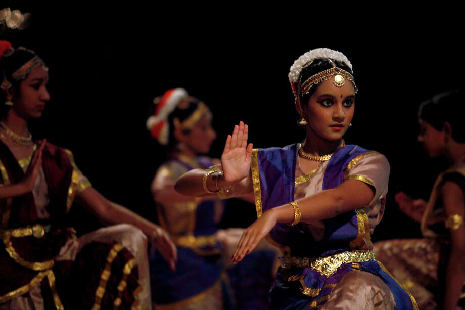 Swathi Peddaiahgari, 16, performs with dancers from the Arathi School of Indian Dance at the Arneson River Theater during the first city-wide celebration of Diwali: the Festival of Lights in San Antonio on Sunday, Nov. 1, 2009. Photo: Lisa Krantz, San Antonio Express-News / lkrantz@express-news.net