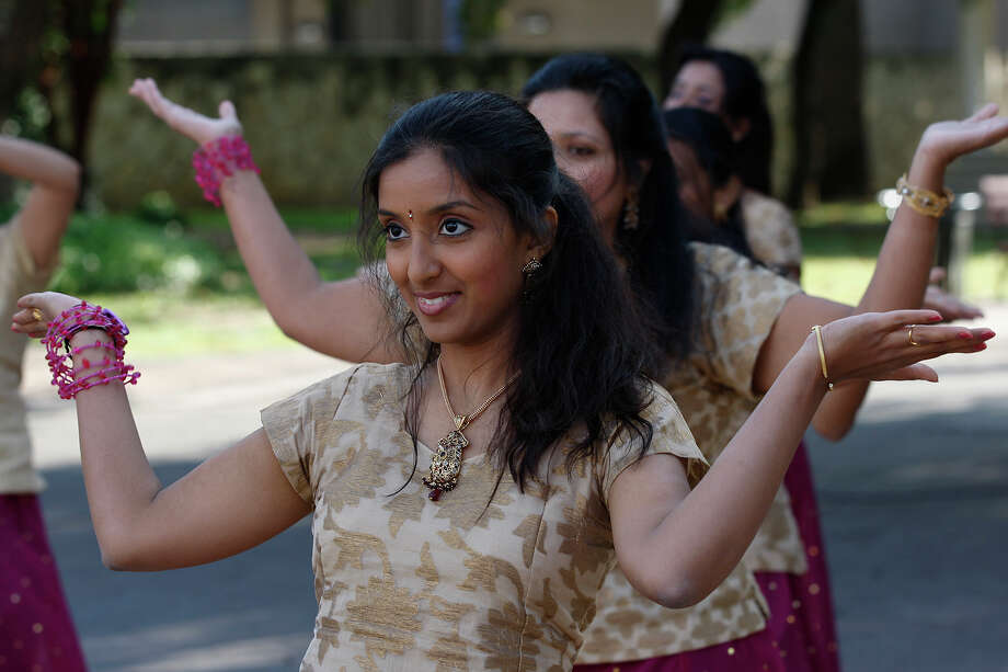 Vijayalskshmi Chavali and other members of the Exquisite Dancers troupe perform during a media conference announcing the upcoming second annual Diwali at HemisFair Park, Thursday, Oct. 28, 2010. Photo: Jerry Lara, San Antonio Express-News / glara@express-news.net