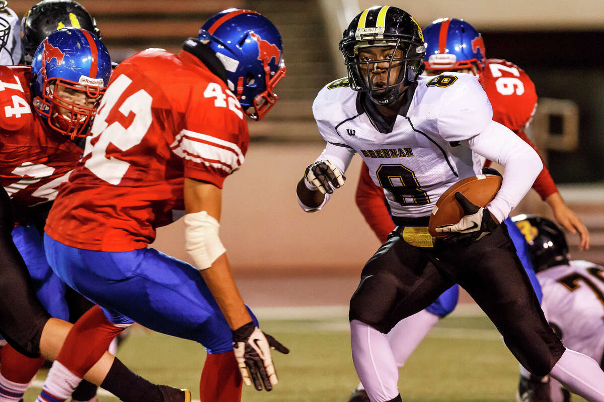Brennan running back Nathanial Wells Jr (right) looks for running room as Jefferson's Roger Morales comes up to stop him during the second quarter of their game at Alamo Stadium on Nov. 2, 2012. Brennan won the game 14-0 . MARVIN PFEIFFER/ mpfeiffer@express-news.net