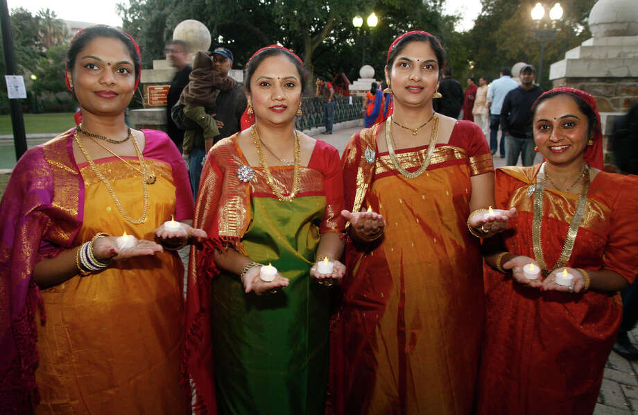 Poornima Nikkam (from left), Girija Adikeshava, Mathangi Purushotham and Yasmin Siddiqui at Diwali San Antonio,the Indian festival of lights, Saturday, Nov. 6, 2010, at HemisFair Park. Photo: J. Michael Short, For The Express-News / THE SAN ANTONIO EXPRESS-NEWS
